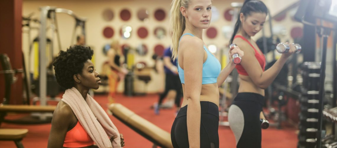 women-in-sports-bra-and-black-leggings-while-doing-exercise-3776144